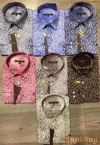 Классические сорочки GUCCI разных цветов с узорами.